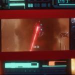 PIC-S01E02-13-Paineis Mostrando Ataque em Marte